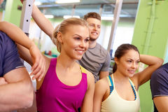 Group of happy friends in gym Stock Images