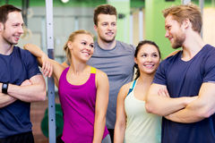 Group of happy friends in gym. Fitness, sport and people concept - group of happy friends in gym stock images