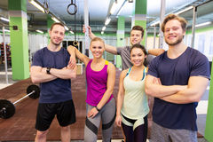 Group of happy friends in gym. Fitness, sport and people concept - group of happy friends in gym Royalty Free Stock Photos