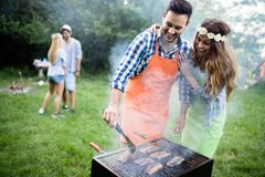 Group of happy friends having barbecue party in forest. Group of friends having barbecue party in forest stock photos
