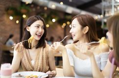 Happy friends having dinner in the restaurant stock photography