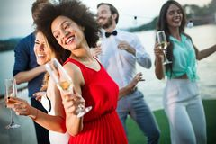 Group of friends having fun and celebrating group gathering stock images