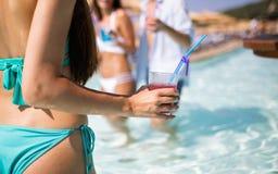 Group of happy friends having fun dancing at swimming pool outdoors. Group of happy friends having fun dancing at swimming pool with cocktails stock image