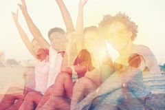 Group of happy friends having fun at ocean beach. double exposure royalty free stock image