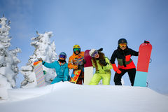 Group happy friends having fun at Sheregesh ski resort. Skiers and snowboarders team concept royalty free stock photo