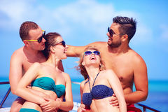 Group of happy friends having fun on yacht, during summer vacation Stock Image