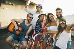 Group of happy friends having party on rooftop. Group of happy young friends having party on rooftop Royalty Free Stock Images