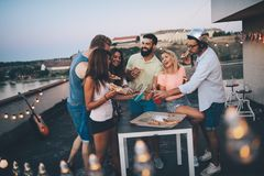 Group of happy friends having party on rooftop royalty free stock image