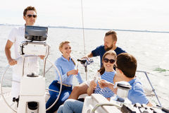 Group of happy friends having a party on a yacht. And drinking champagne. Vacation, holiday, traveling, concept royalty free stock photography