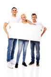 Group of happy friends holding empty banner Stock Photography