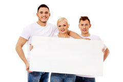 Group of happy friends holding empty banner Royalty Free Stock Photo