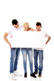 Group of happy friends holding empty banner Royalty Free Stock Images