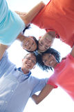 Group of happy friends huddling Stock Photo