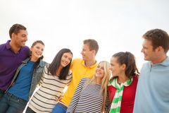 Group of happy friends hugging and talking Royalty Free Stock Image
