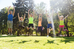 Group of happy friends jumping high outdoors Royalty Free Stock Images