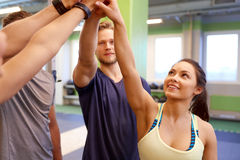 Group of happy friends making high five in gym Royalty Free Stock Images