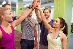 Group of happy friends making high five in gym Royalty Free Stock Photos
