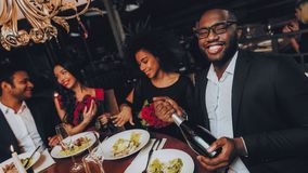 Group of Happy Friends Meeting and Having Dinner stock image