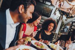 Group of Happy Friends Meeting and Having Dinner royalty free stock photo