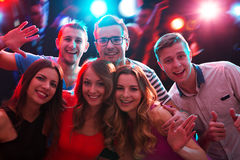 Group of happy friends in the night club Royalty Free Stock Images