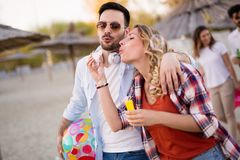 Group of happy friends partying on beach. And having fun Stock Photo