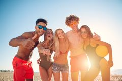 Group of friends playing at beach volley at the beach royalty free stock photography