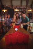 Group of happy friends playing game. In pub Royalty Free Stock Images