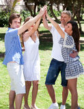Group of happy friends with raised arms Stock Photography