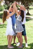 Group of happy friends with raised arms Royalty Free Stock Photo