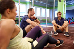 Group of happy friends resting in gym Stock Photography