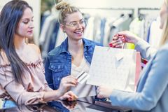 Picture of group of happy friends shopping for clothes in mall royalty free stock image