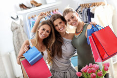 Group of happy friends shopping in store. Picture showing group of happy friends shopping in store stock image