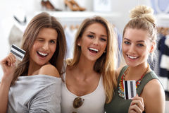 Group of happy friends shopping in store. Picture showing group of happy friends shopping in store royalty free stock photography