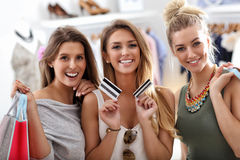 Group of happy friends shopping in store. Picture showing group of happy friends shopping in store royalty free stock photos