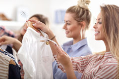 Group of happy friends shopping in store. Picture showing group of happy friends shopping in store stock photo