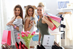 Group of happy friends shopping in store. Picture showing group of happy friends shopping in store royalty free stock photo