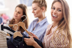Group of happy friends shopping in store. Picture showing group of happy friends shopping in store stock images