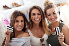 Group of happy friends shopping in store. Picture showing group of happy friends shopping in store royalty free stock image