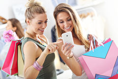 Group of happy friends shopping in store. Picture showing group of happy friends shopping in store royalty free stock images