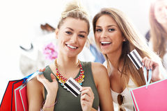 Group of happy friends shopping in store Royalty Free Stock Images
