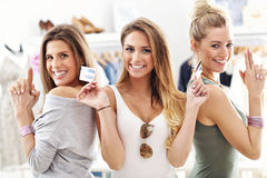 Group of happy friends shopping in store Stock Photography