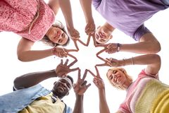 Group of happy friends showing peace hand sign Stock Image