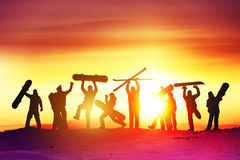 Group happy friends ski resort. Group of happy friends having fun on at sunset time. Snowboard and ski concept royalty free stock photo