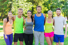 Group of happy friends or sportsmen outdoors Stock Photography