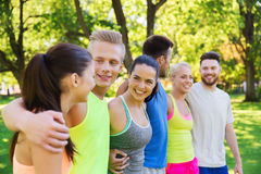 Group of happy friends or sportsmen outdoors Stock Photos