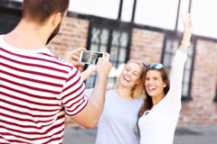 Group of happy friends taking pictures in the city Royalty Free Stock Images