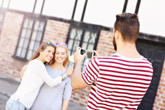 Group of happy friends taking pictures in the city Royalty Free Stock Photography