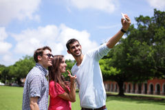 Group of happy friends taking selfie Stock Photography