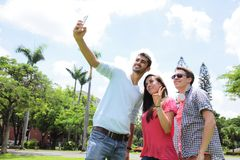 Group of happy friends taking selfie Royalty Free Stock Photography