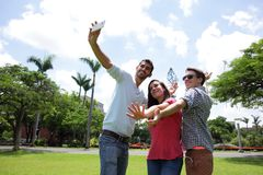 Group of happy friends taking selfie Stock Photos